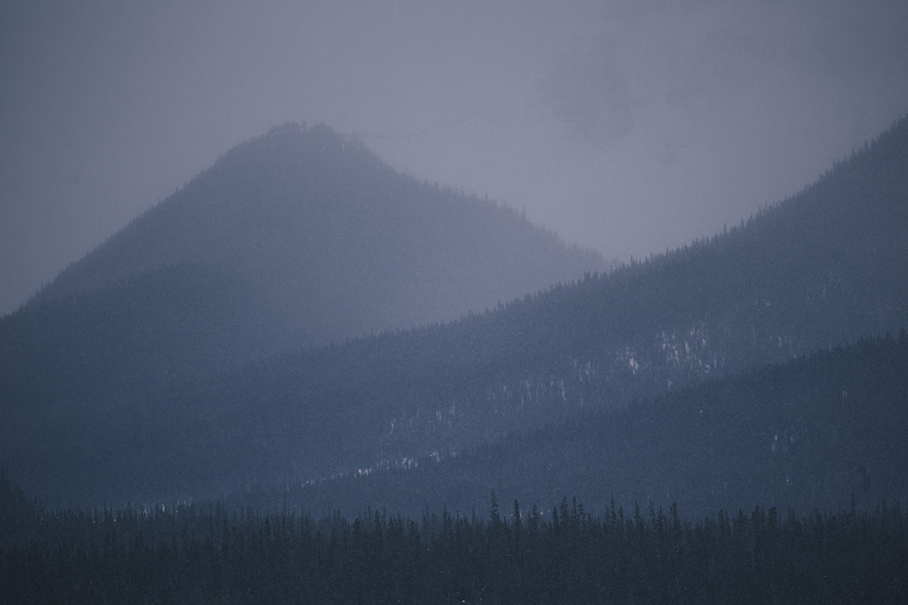 Rocky mountains in fog Jasper Alberta